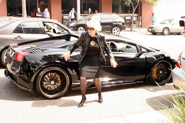 Joan Rivers (Celebrity Apprentice) exits a Lamborghini in Beverly Hills