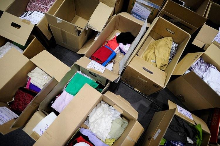 Volunteers Gather Donations For Migrants