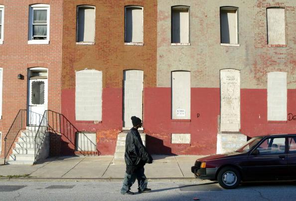 man walking on street in baltimore