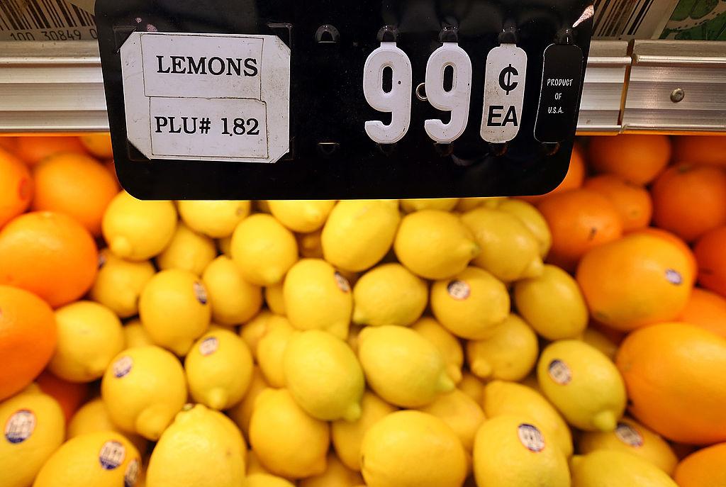 a bunch of lemons on display