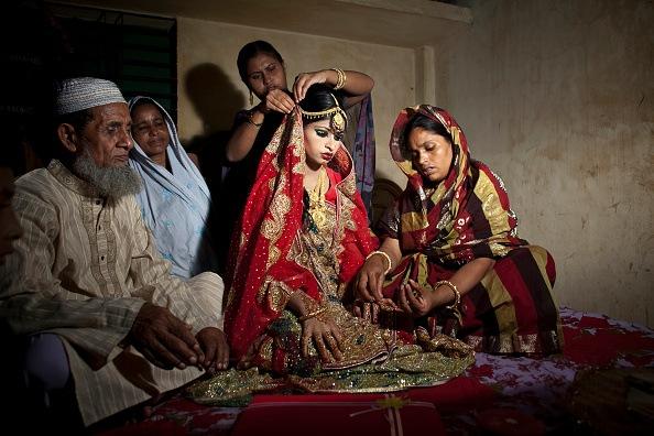 family in Bangladesh sitting on floor