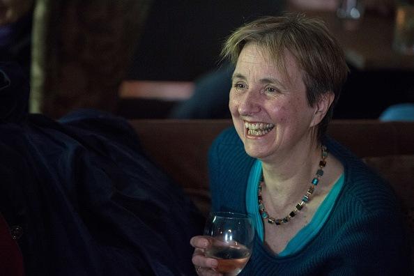 lady drinking alcohol at bar