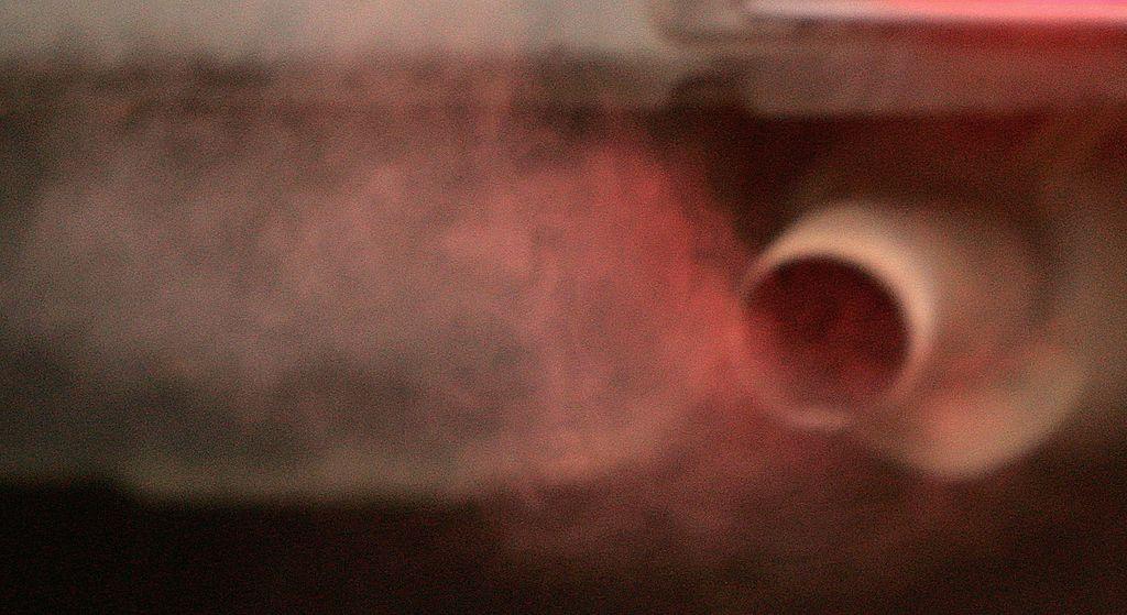 car polluting the air