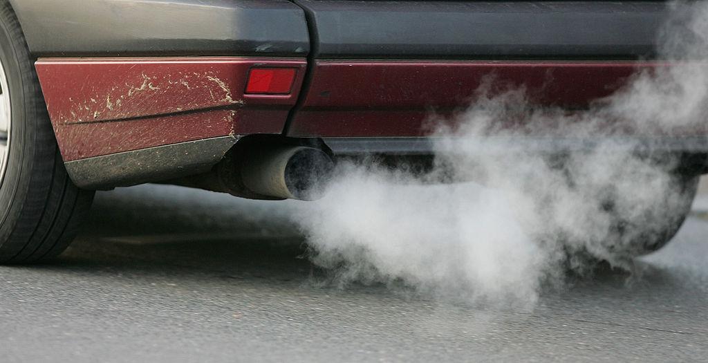 car tail pipe blowing smoke